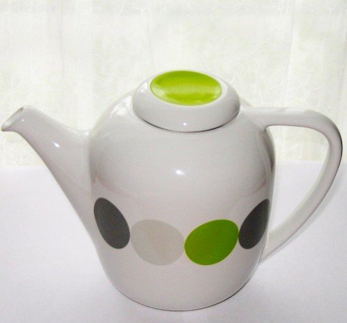 Teapot with infuser in it